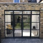 New aluminium doors in the old metal style